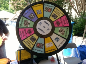 The Wheel of Justice features spokes for history, employment, accessibility, technology, independent living movement, on the job, and knowing your right.